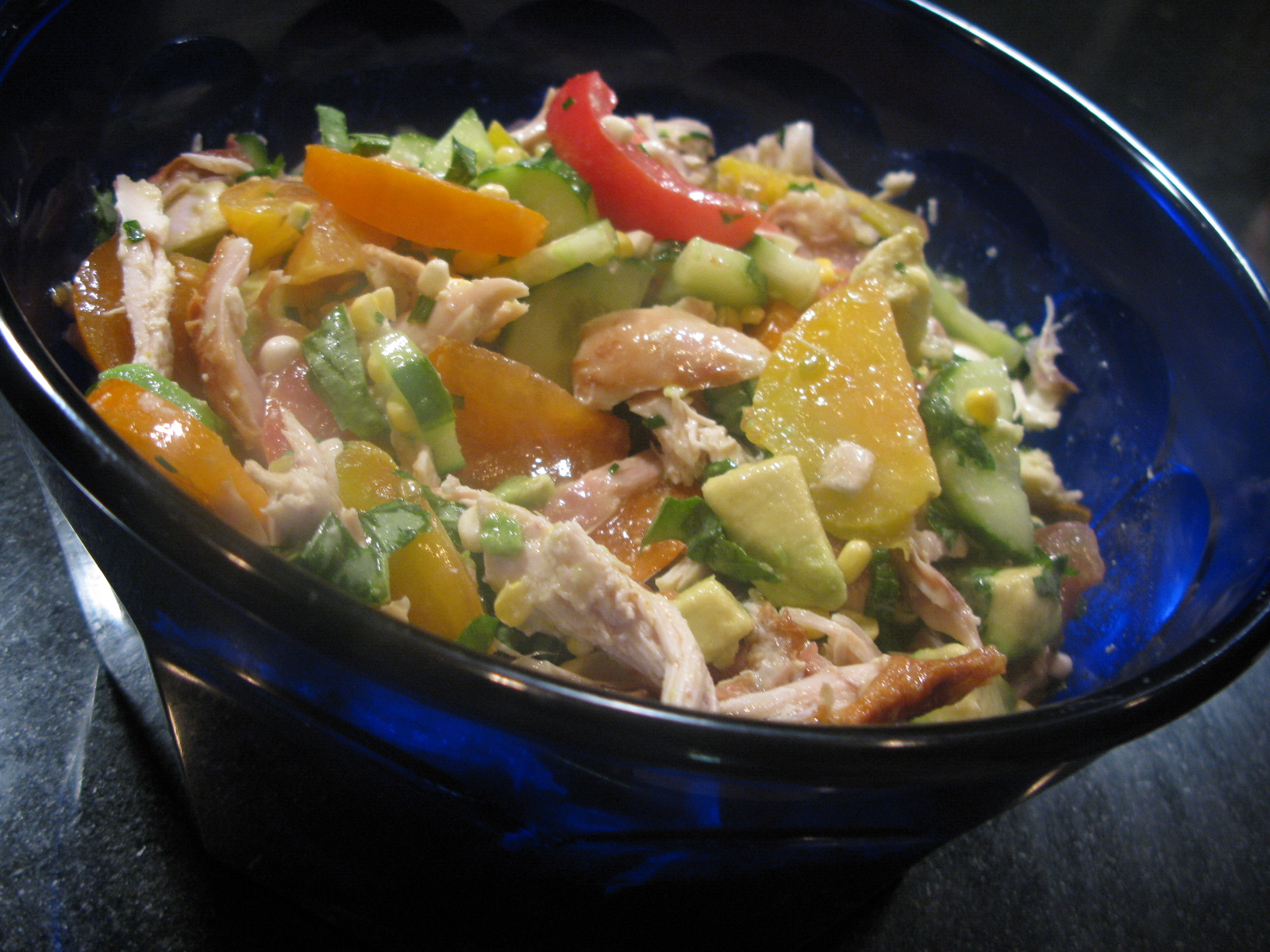 Honey-Citrus Chicken Salad with Avocado, Persimmon, and Heirloom Tomatoes